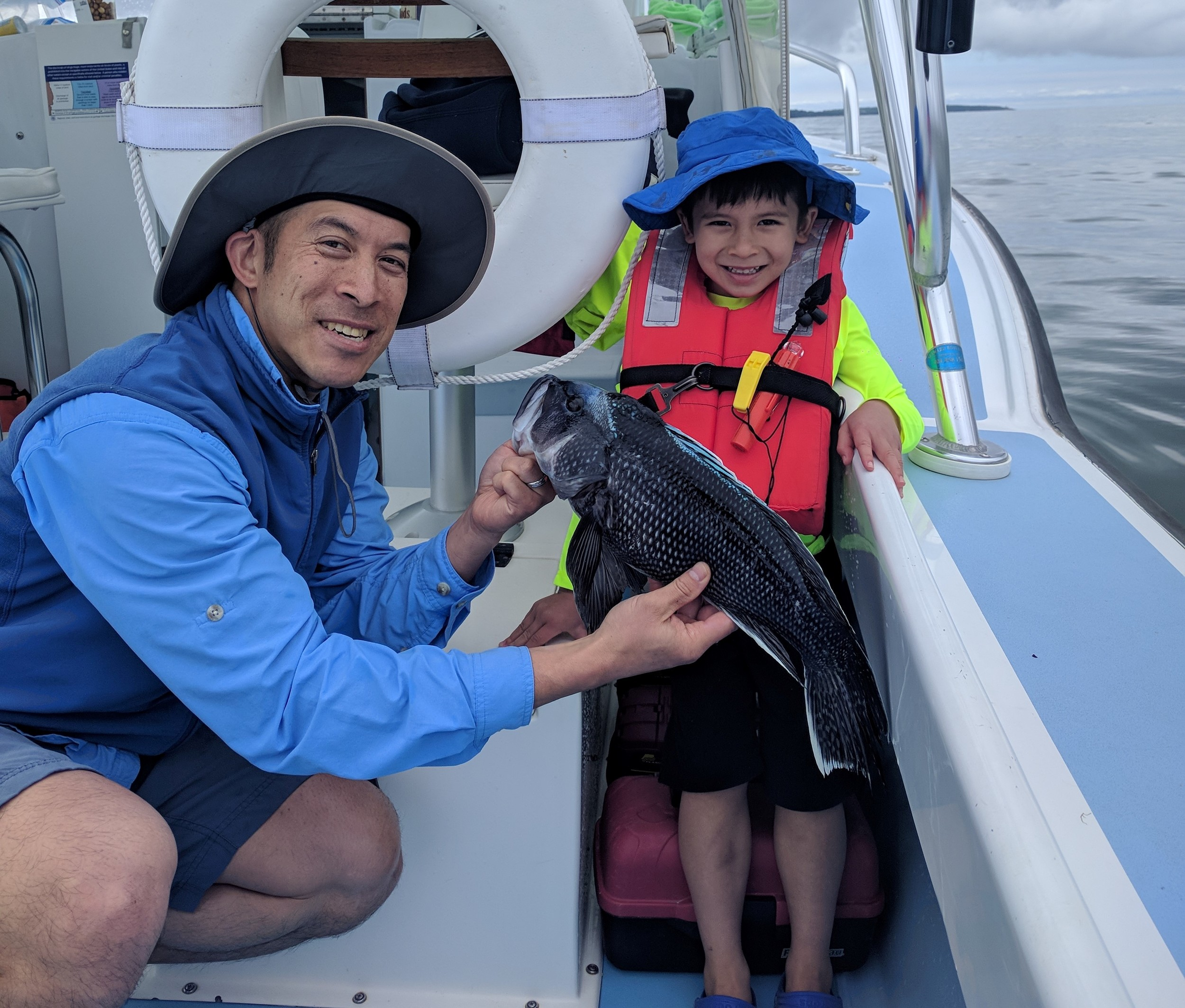 "Jamie Wong and son Xavier (4) on a family fishing trip caught black sea bass, scup, sea robins and fluke.  The black sea bass season in RI opens June 24 with a 15"" min. size and a three fish/person/day limit."