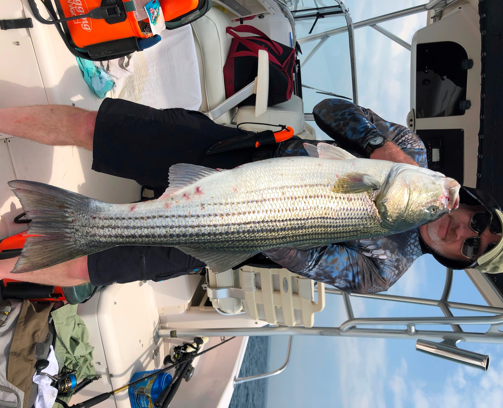 Greg Vespe with a striped bass caught using a top-water lure off Newport mid-day, Wednesday, July 4.