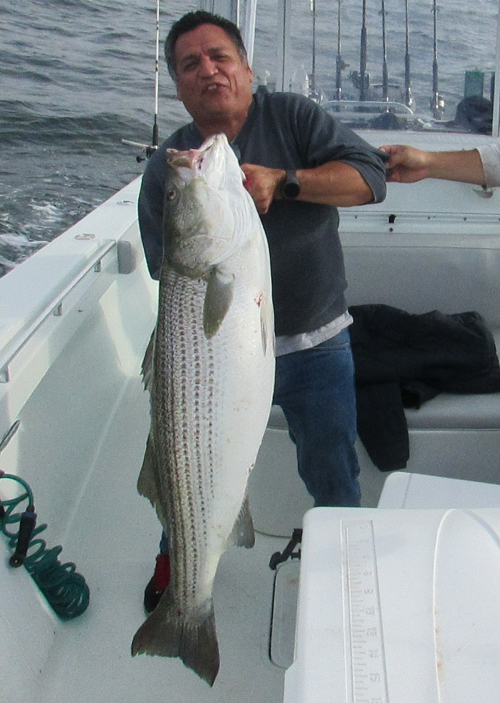Juan Santacruz of Haverhill, MA with a 60 pound striped bass he caught on Capt. Sheriff Fishing Charters while fishing with parachute jigs on the Southwest Ledge side of Block Island this weekend.
