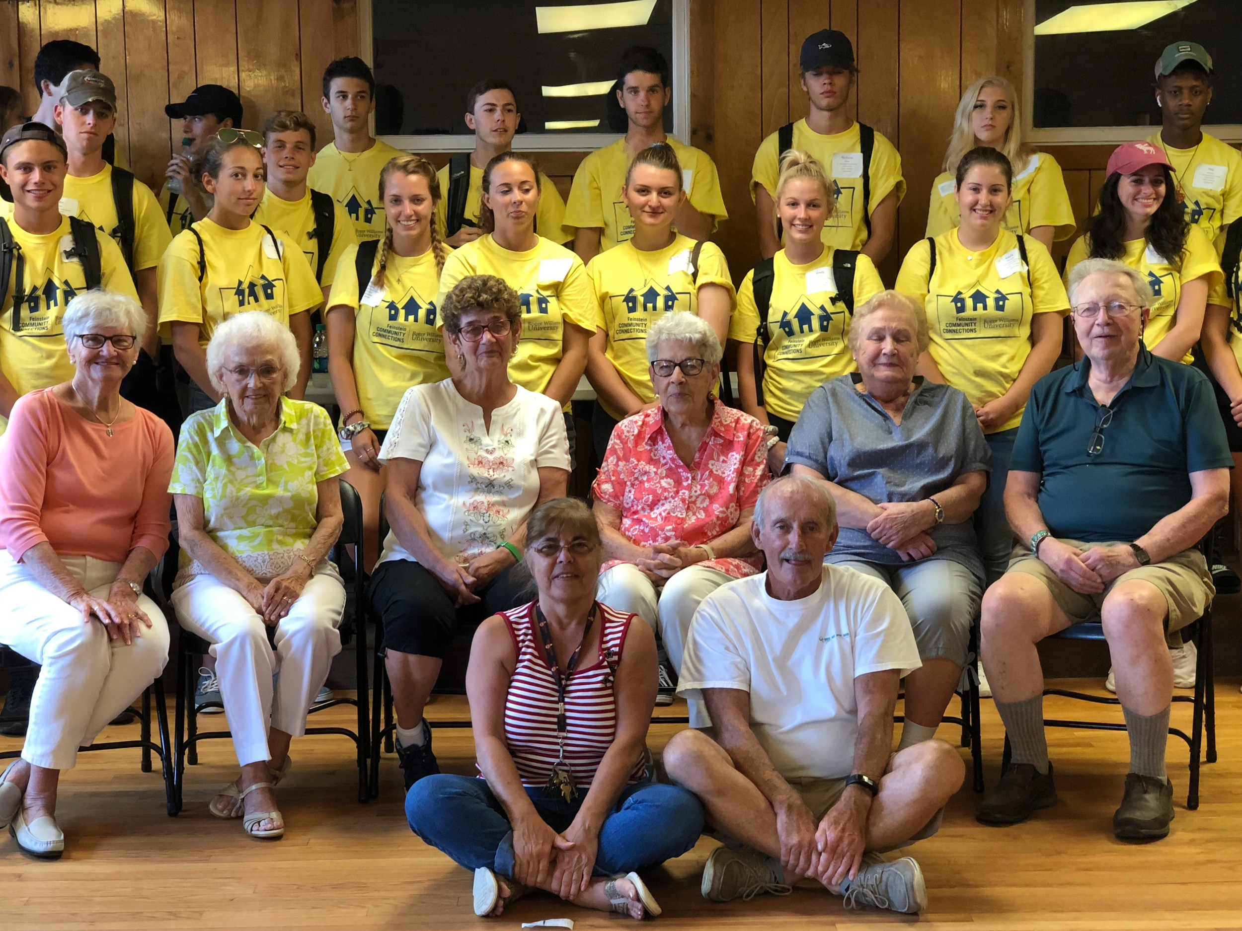 Incoming freshmen from Roger Williams University with members of the Portsmouth Multi-Purpose Senior Center, where they helped with various tasks during the 14th annual Feinstein Community Connections Day on Monday.