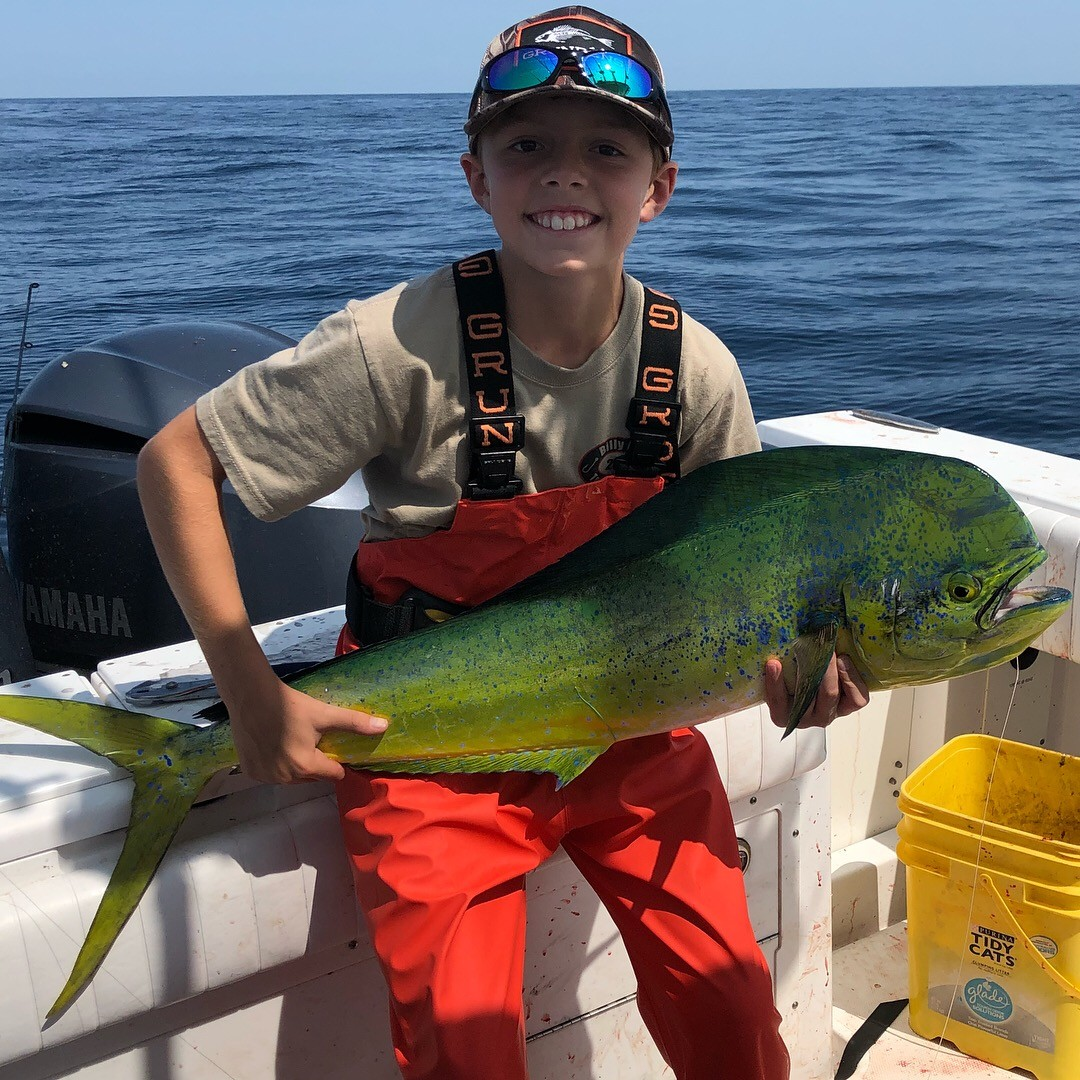 Everett Baldwin of Rumford with a mahi he caught when fishing with his father John at the Fish Tails (about 70 miles south of Montauk Point, NY) with squid and spinning reel at a high flyer buoy.
