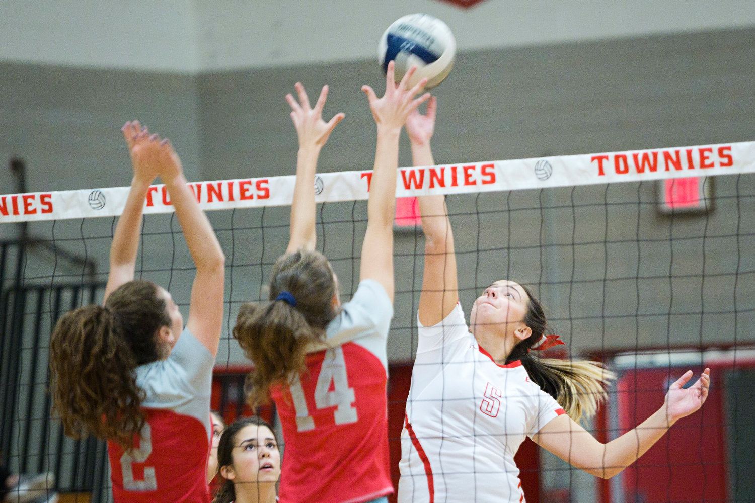 Aly Batty attempts to get the ball past Cranston West opponents.