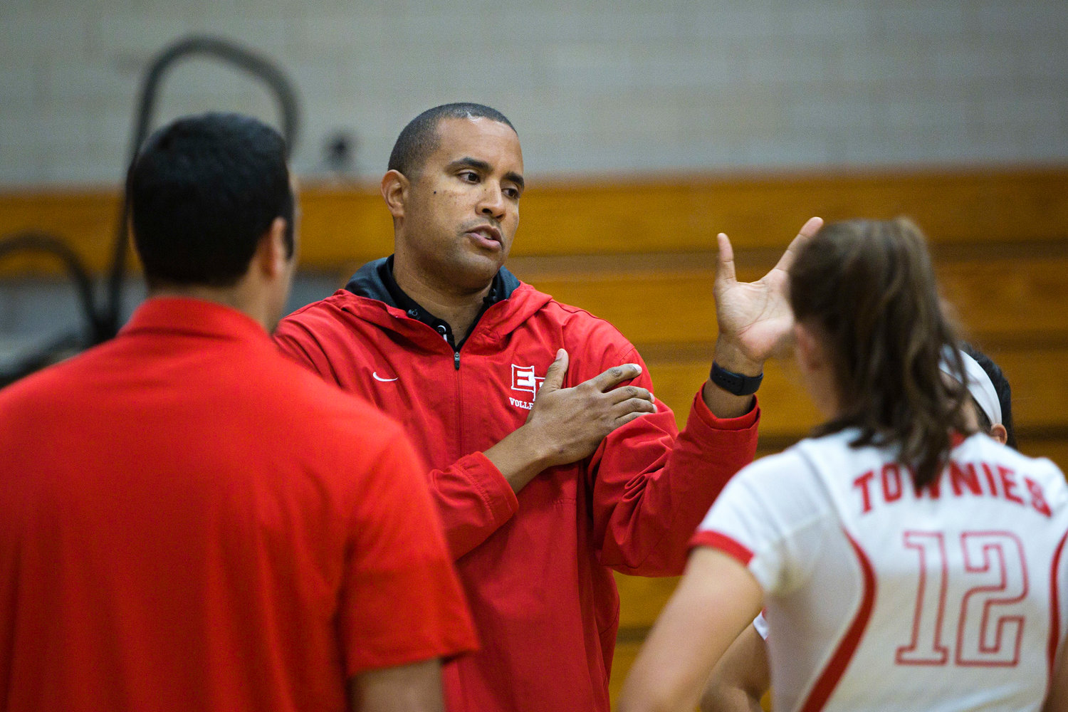EPHS Head Coach Alex Butler talks strategy during a time-out.