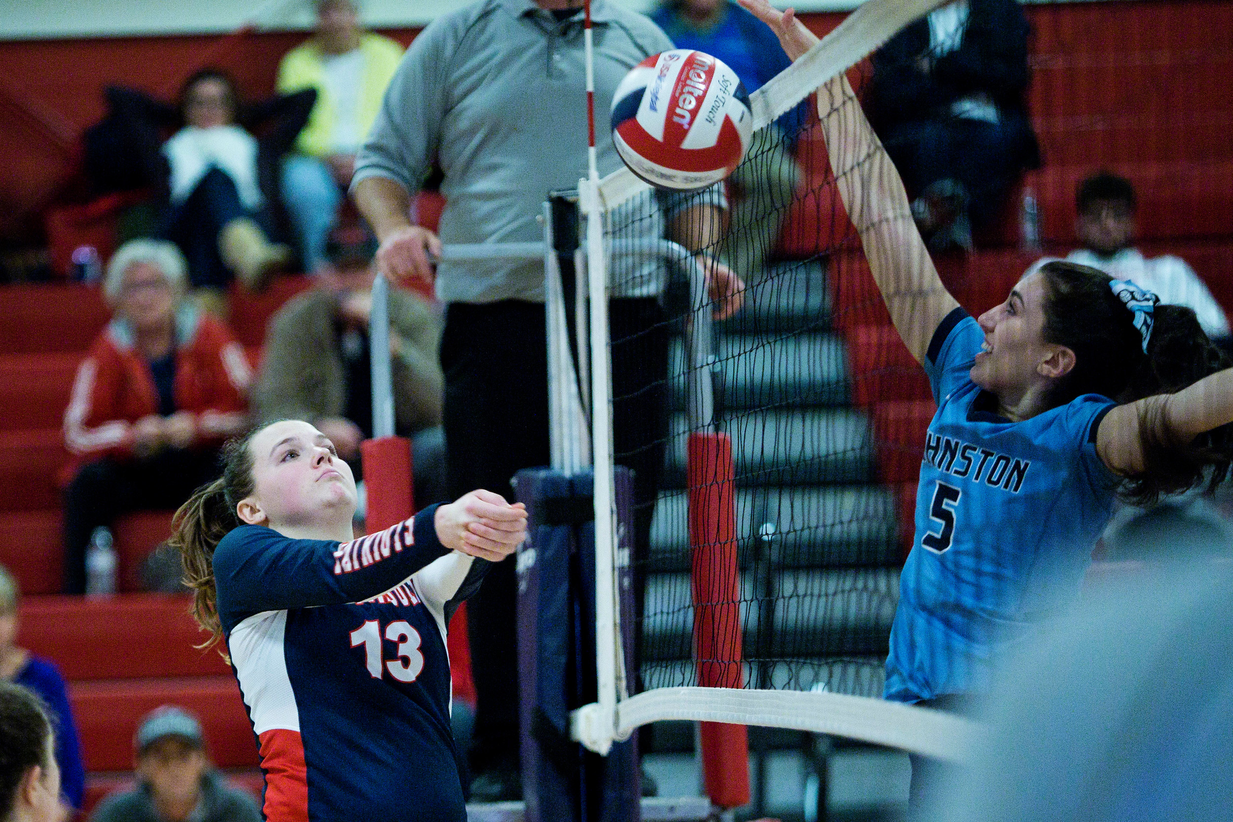 A Johnston player jumps to block Portsmouth's Celia von Recum from sending the ball over the net.