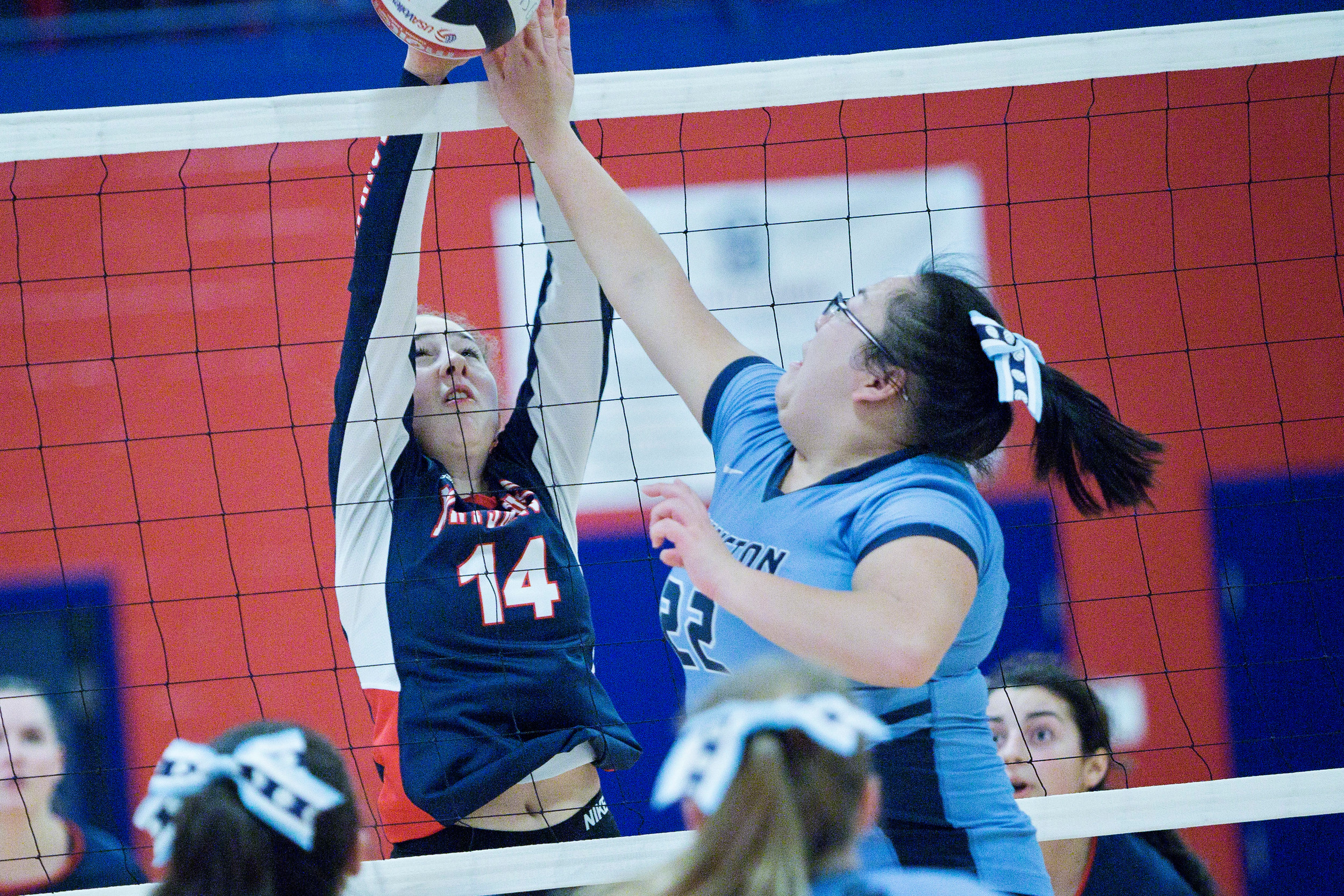 Jill Lunney blocks a Johnston player from sending the ball back over the net.