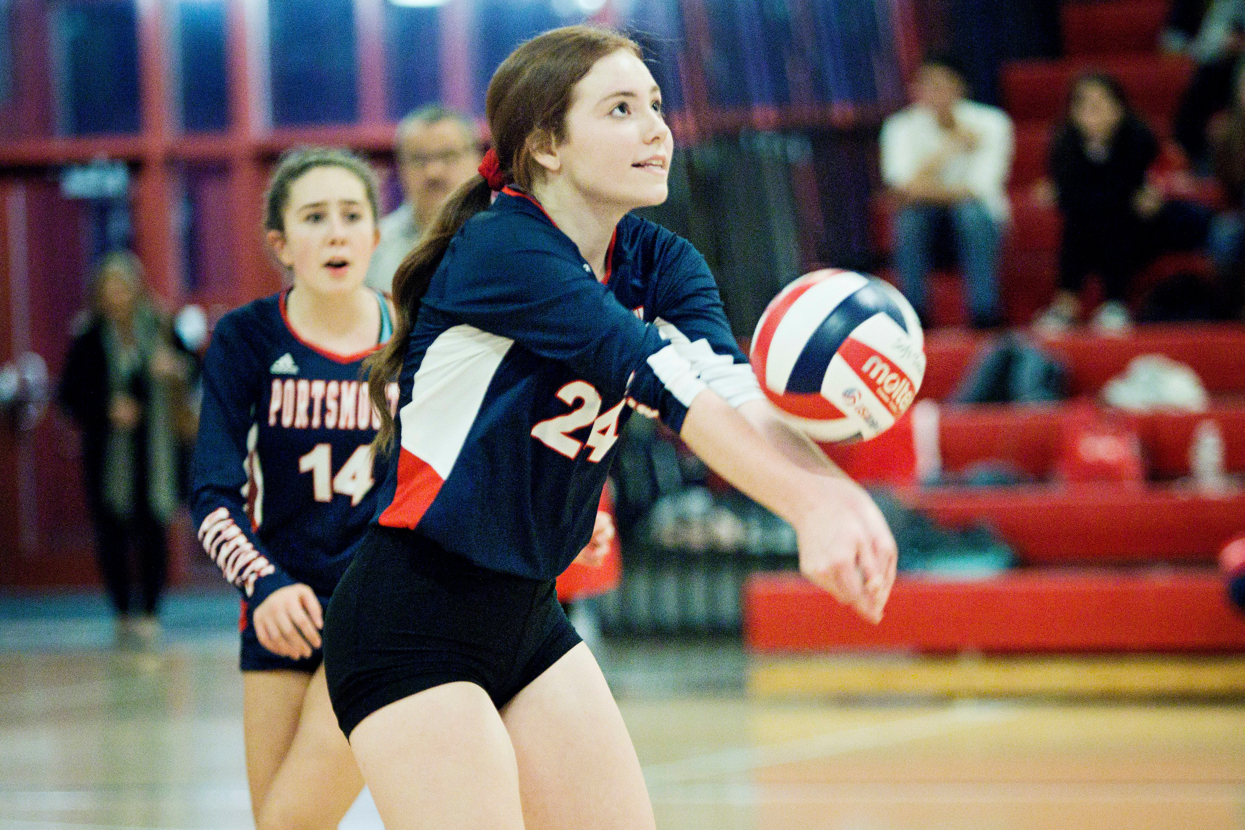 Grace Riccio bumps the ball to a teammate.