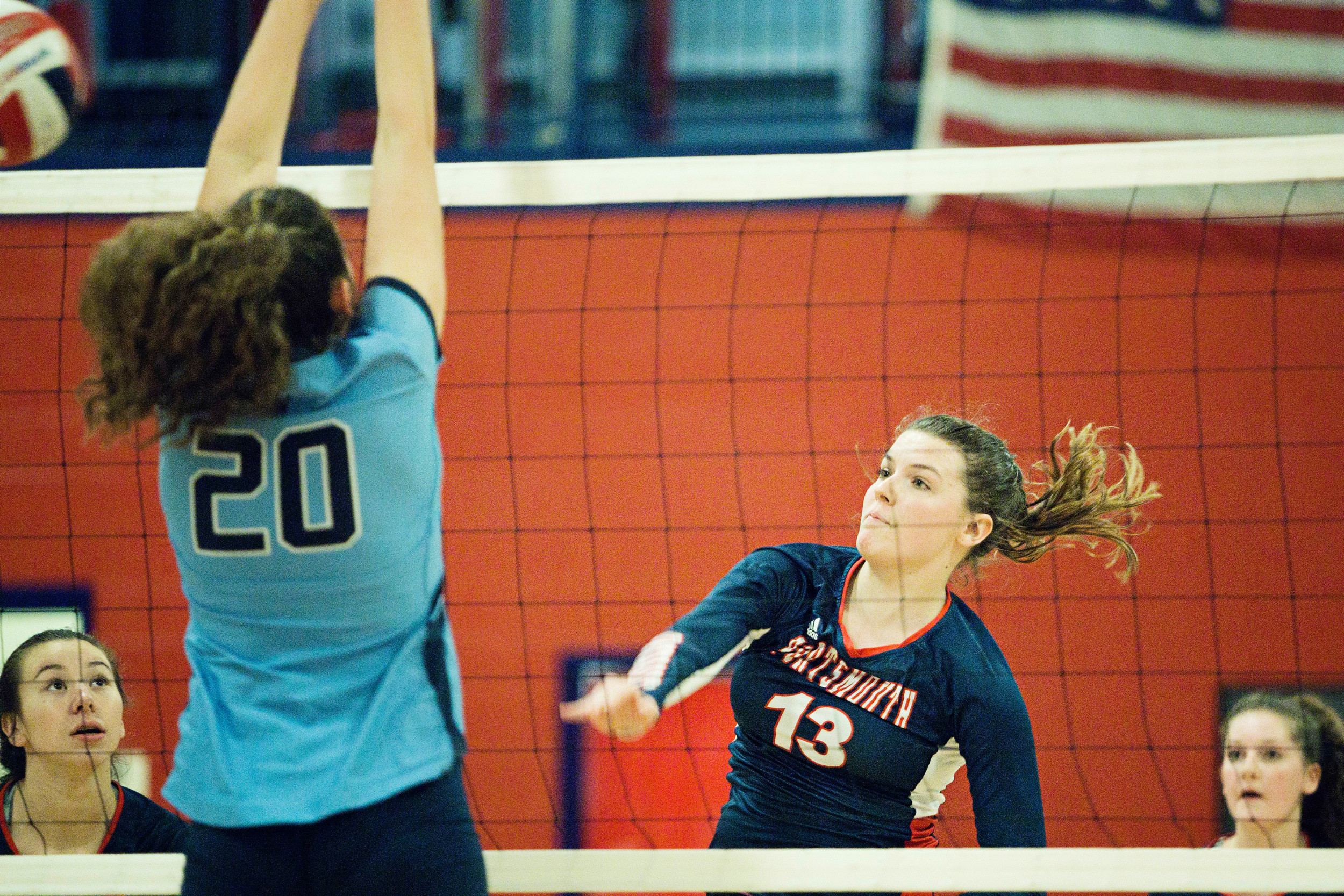 Celia von Recum spikes the ball to the Johnston side of the net. She notched eight aces and four kills for the Patriots.