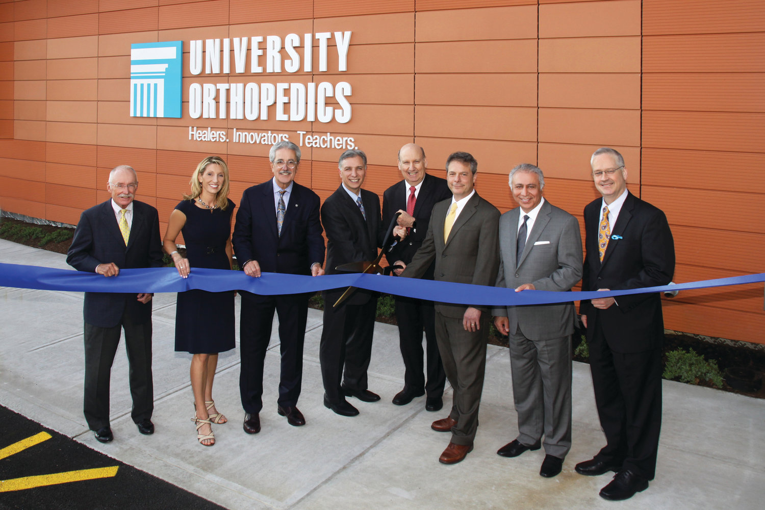 From left to right, Edward Burman Jr., president of EW Burman Inc.; Kathy Snelgrove, COO of University Orthopedics; Michael Integlia, president of Michael Integlia & Co.; Mark Palumbo, MD, University Orthopedics; Edward Akelman, MD, president of University Orthopedics; Weber Shill, CEO of University Orthopedics; Mehdi Khosrovani, president of NEMD Architects Inc.; and East Providence Mayor James Briden.