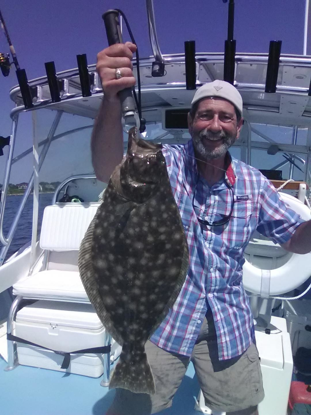 "Capt. Dave Monti with a summer flounder caught off Jamestown this summer. Fish mangers say ""slot limits could have negative impacts on the summer flounder stock, especially under current conditions."""