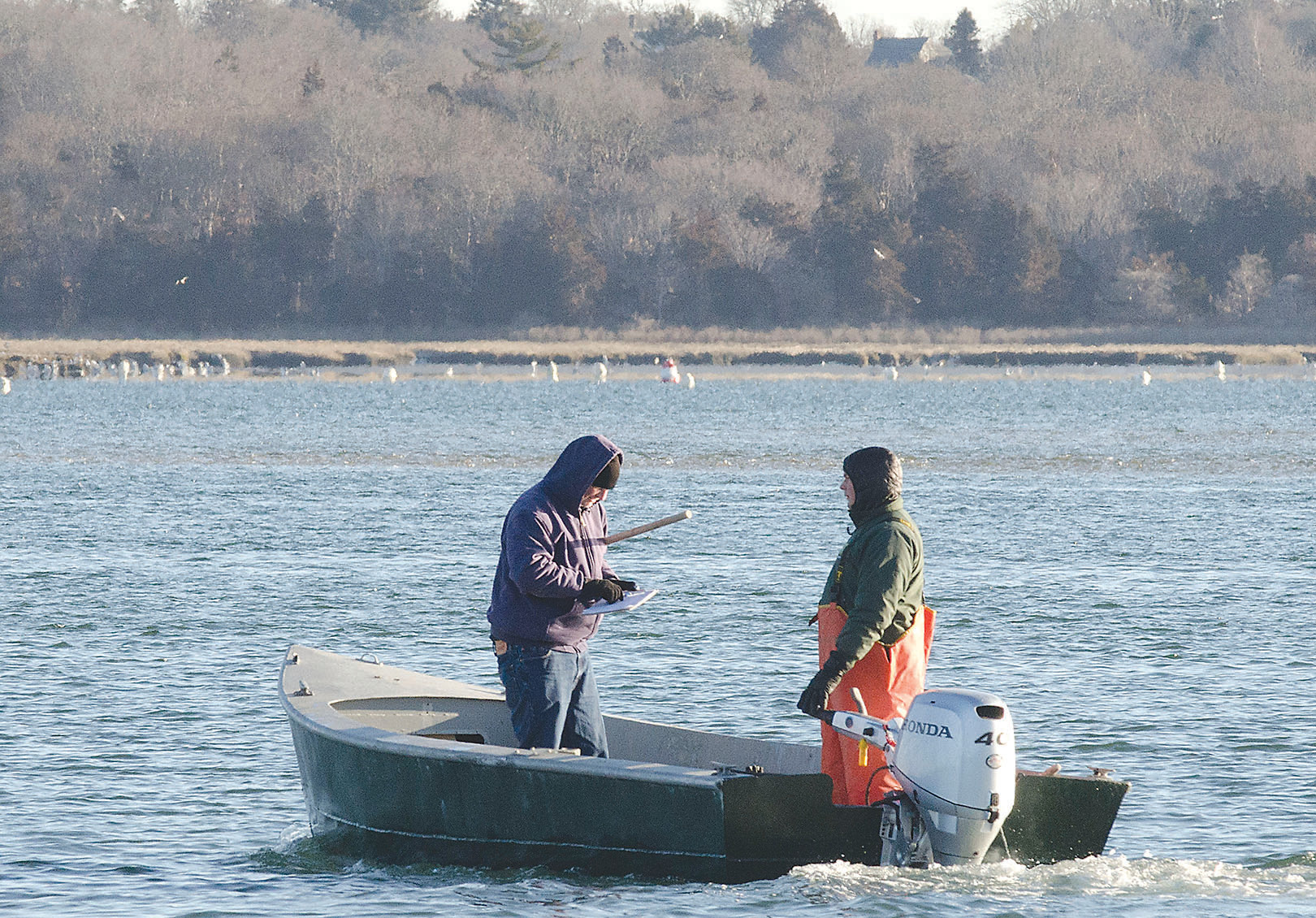 Researchers take water samples in the Westport River's lower West Branch.