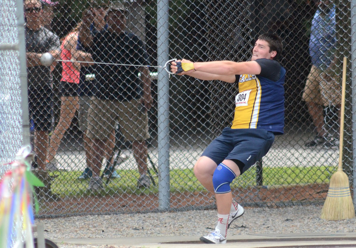Barrington's Bobby Colantonio throws the hammer during the 2016 state track championship.