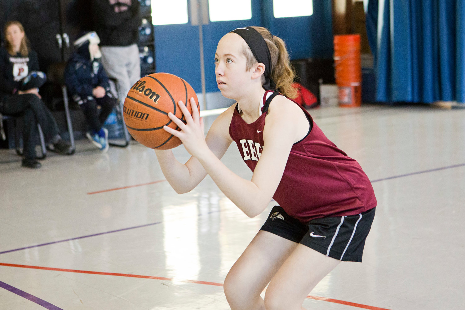 Bailey Howell, 13, takes steady aim while competing in a qualifying round of the Knights of Columbus' free throw contest in the Bradley School gymnasium in Portsmouth in January. Bailey advanced to the State Championships, where on March 24 she was a perfect 25-for-25 to win it all.