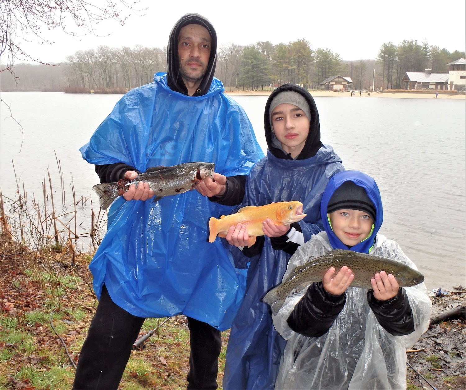Golden Trout is King: Jaymin Deandrade with a golden trout he caught at Only Pond, Lincoln. Shown with his brother Henry and uncle Joe Botelhs, all from East Providence.