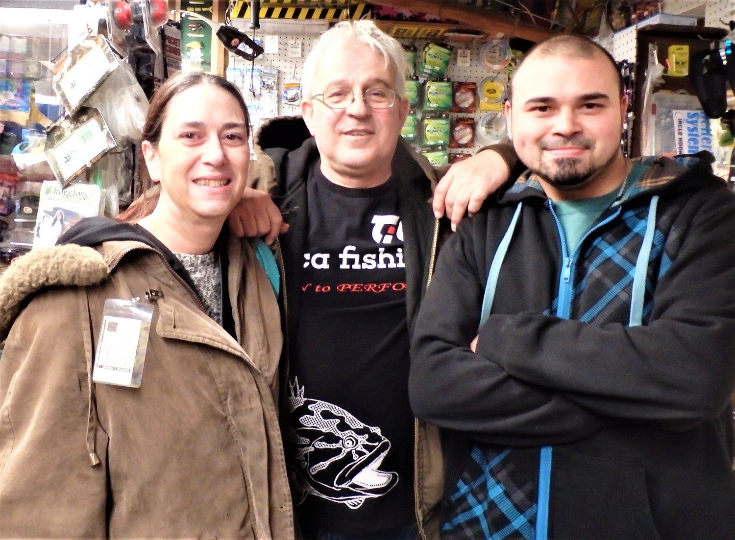 Getting ready: Manny Macedo (center) of Lucky Bait, Warren with customers Brenda Ferreira of East Providence and her son Dan Decrescenzo as they stopped by the store to get ready for opening day.