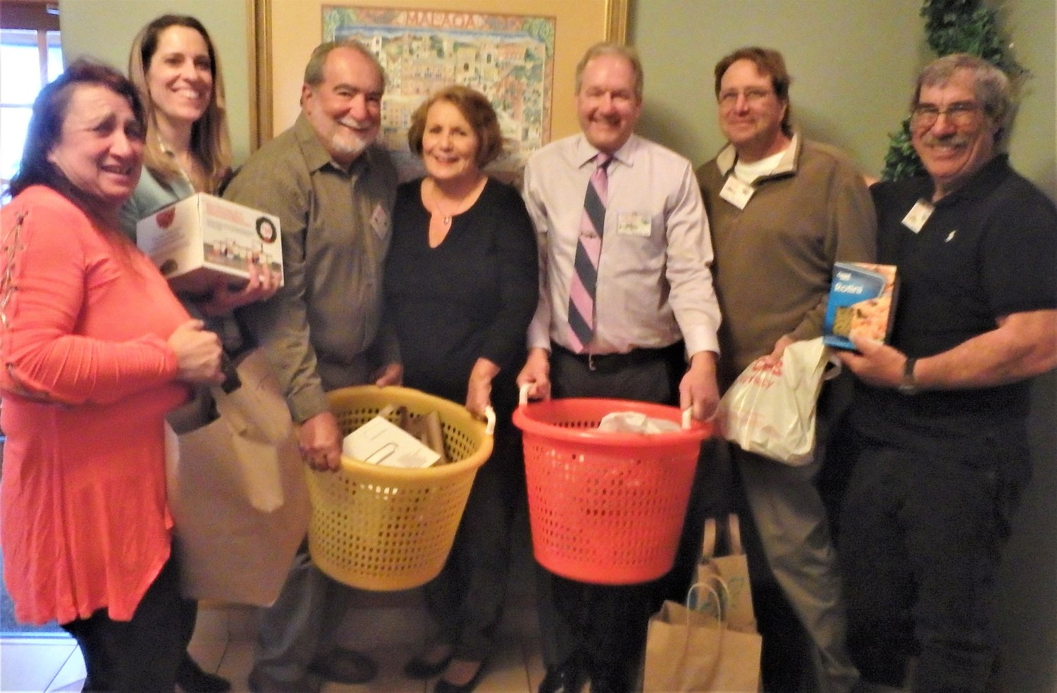 Food and funds donated: Board and Annual Banquet committee members of the Rhode Island Party & Charter Boat Association with food donated to the Johnny Cake Food Pantry in South County.