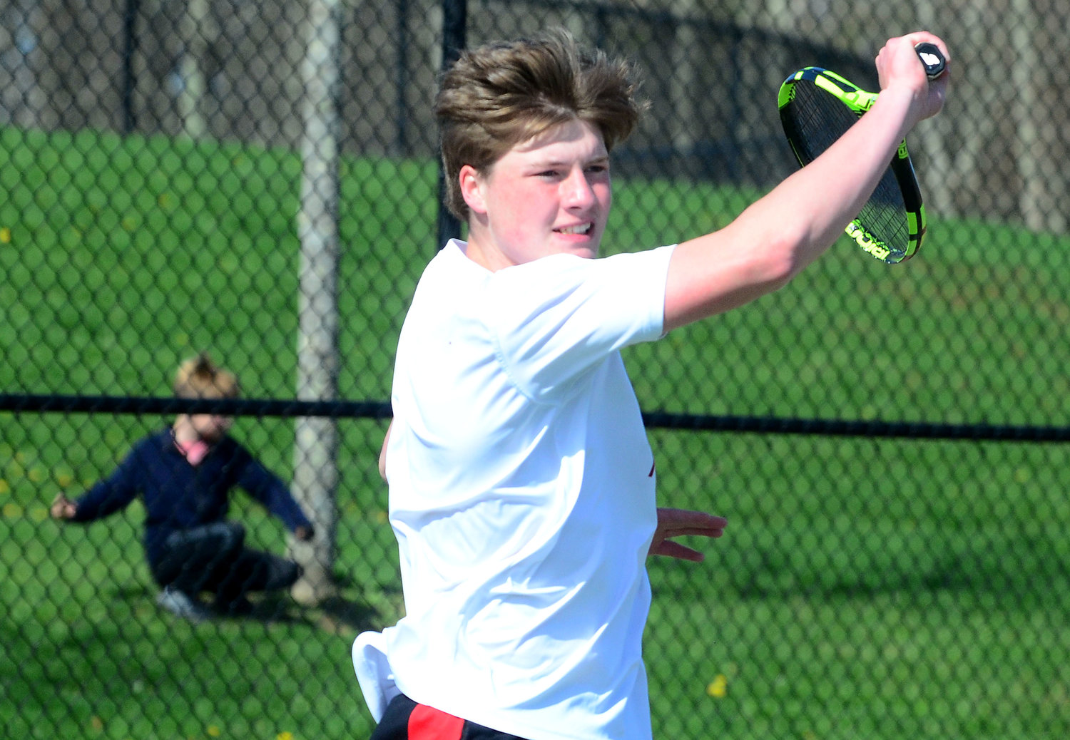Matt Gacioch hits a volley during his match against Gian Salvator.