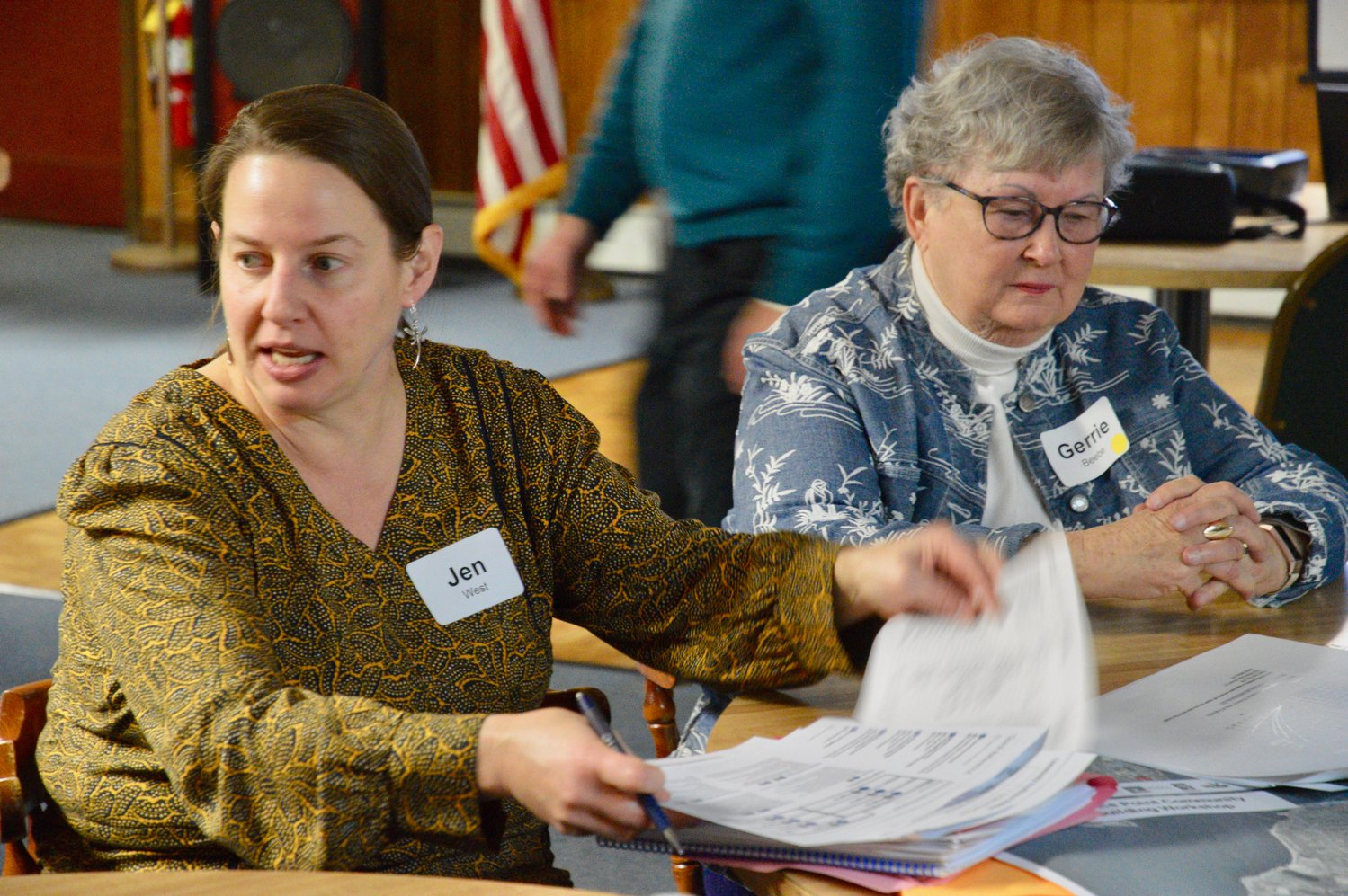 "Jen West (left) discusses coastal resiliency issues with Common Fence Point resident Gerrie Beebe and other members of the ""Yellow Group"" during the workshop at the VFW Hall on Anthony Road."