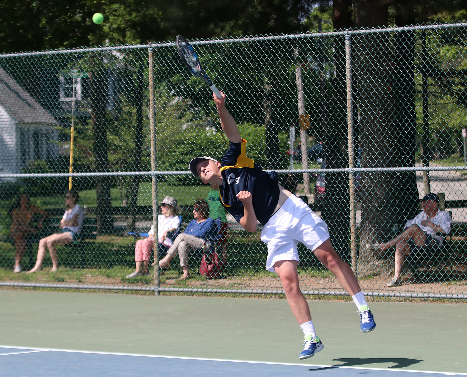 Barrington's Owen Voigt serves the ball during the state finals on Saturday.