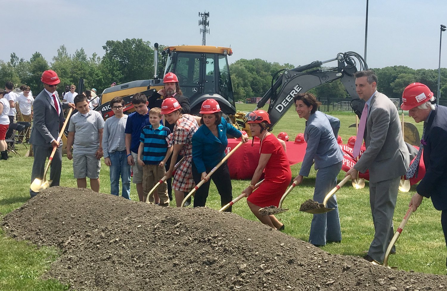State and local officials perform the ceremonial shoveling of dirt at the new East Providence High School groundbreaking event Wednesday, June 6.