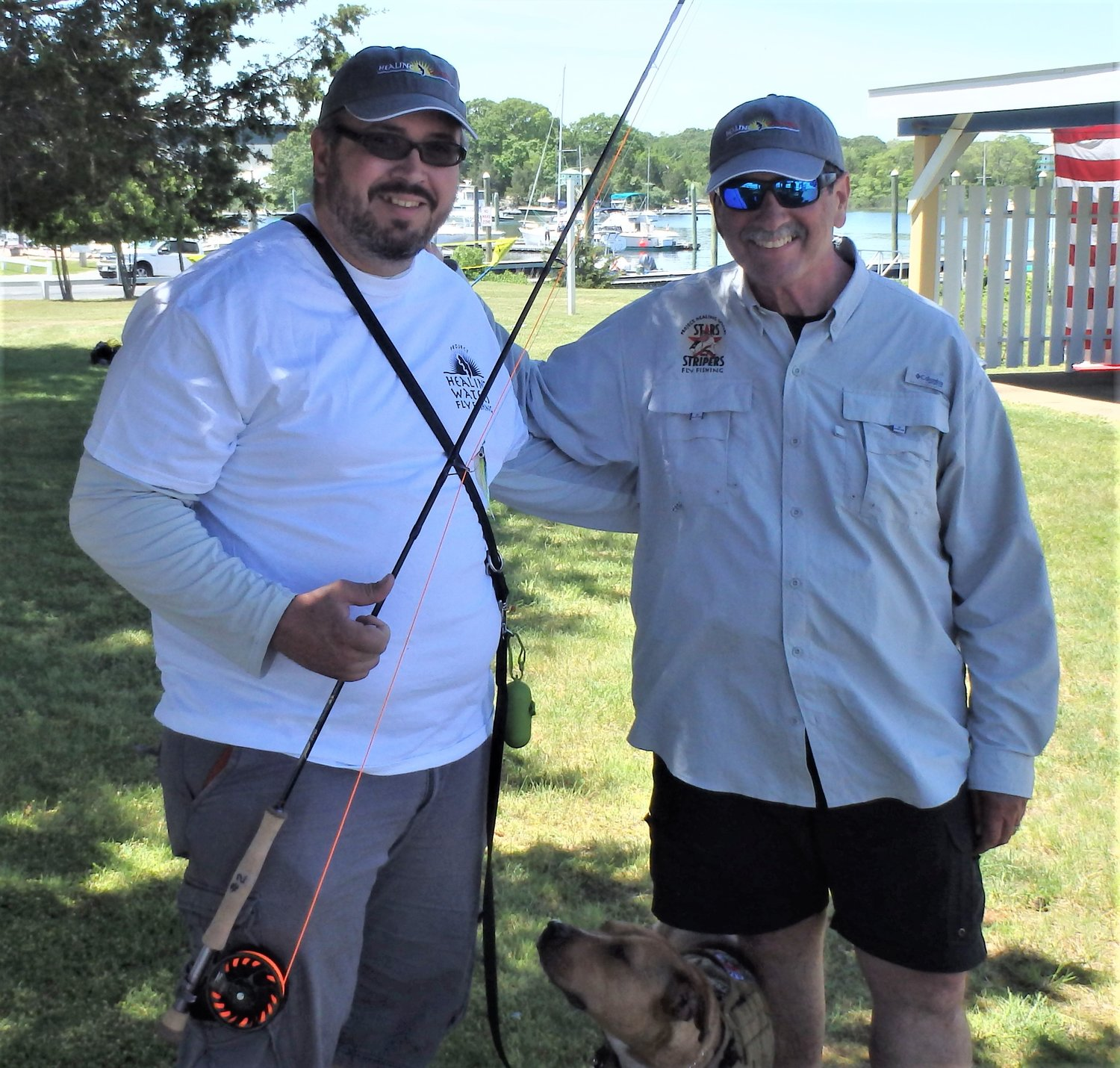 Bluefish bite arrives: Chris Boutin, Marine and Army Guard combat veteran, service dog Freya, and Capt. Monti fished Project Healing Waters as a team. Chris's fly hooked up with multiple bluefish.