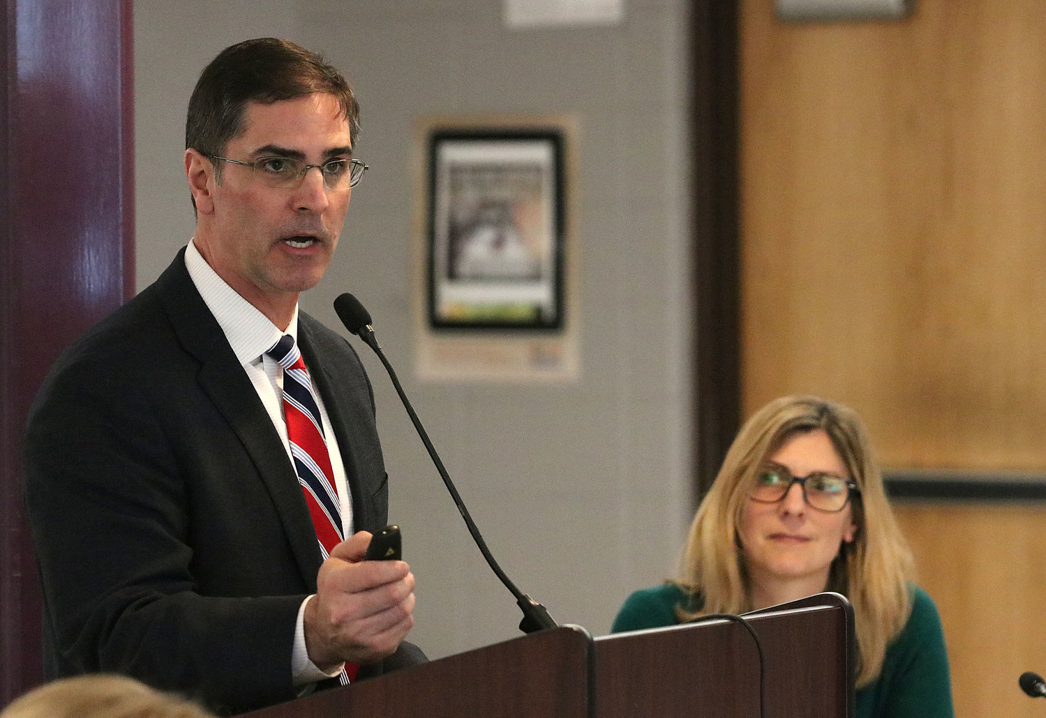 Dr. Mario Andrade addresses the school committee during budget talks earlier this year. Looking on is school committee chairwoman Erin Schofield, who announced his resignation Monday evening.