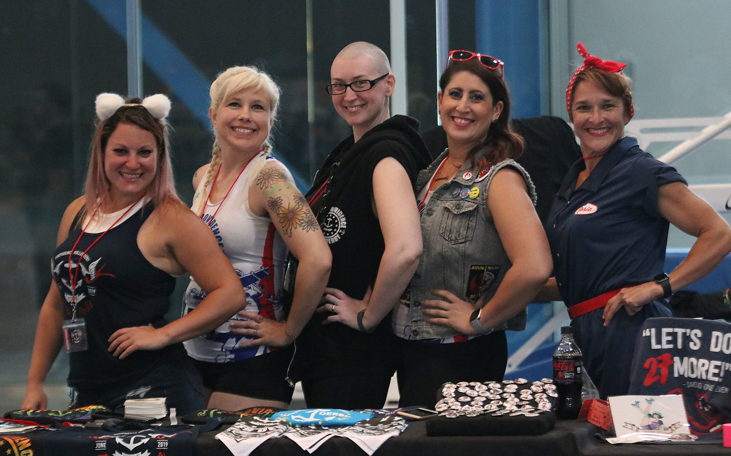 Providence Roller Derby members from left, Shannon Haluck, Sis Boom Bonnie, Apocalypse Meow, Varla Gunz and Rosie Can't Catch-a-Torie pose behind the souvenir