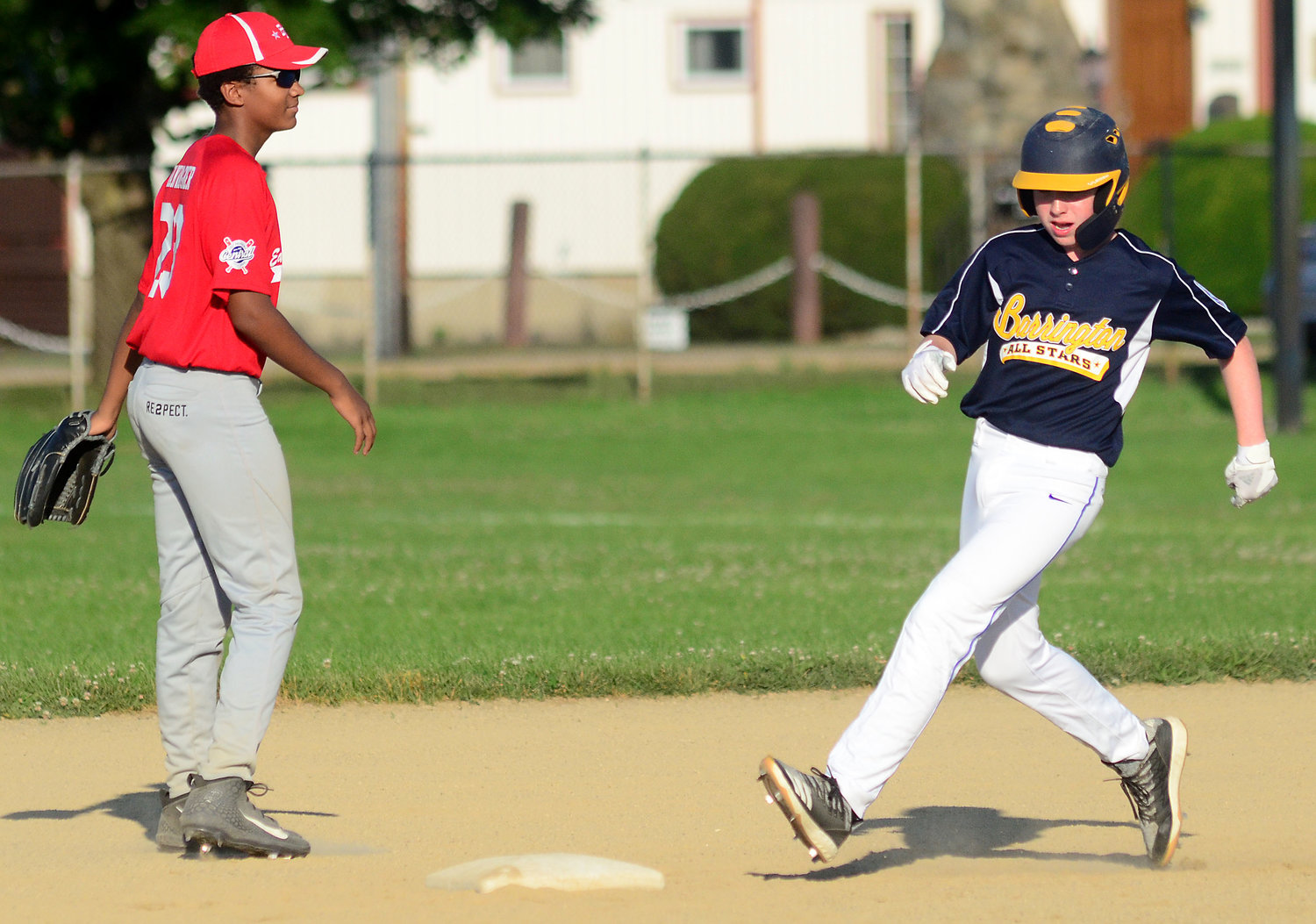 Barrington's Aimon Bickford steals second base during Monday's All-Star game at Barrington High School. At left is East Providence's shortstop Brandyn Van Wagner.