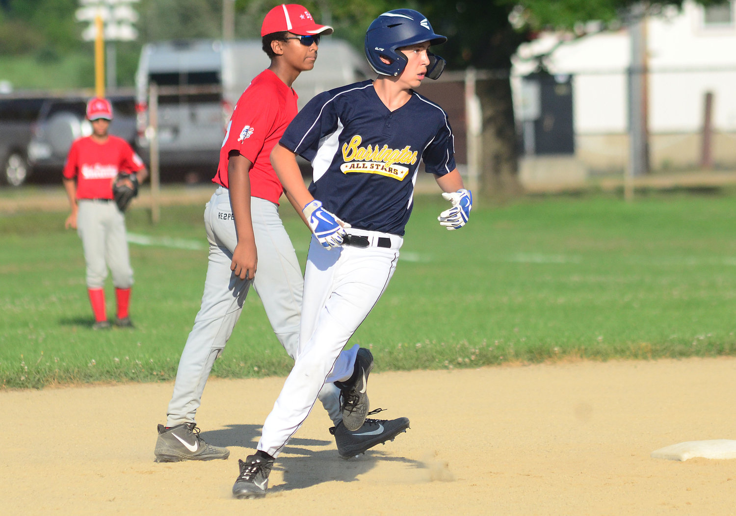 Barrington's Nick Scandura rounds second base during Monday's All-Star game at Barrington High School.