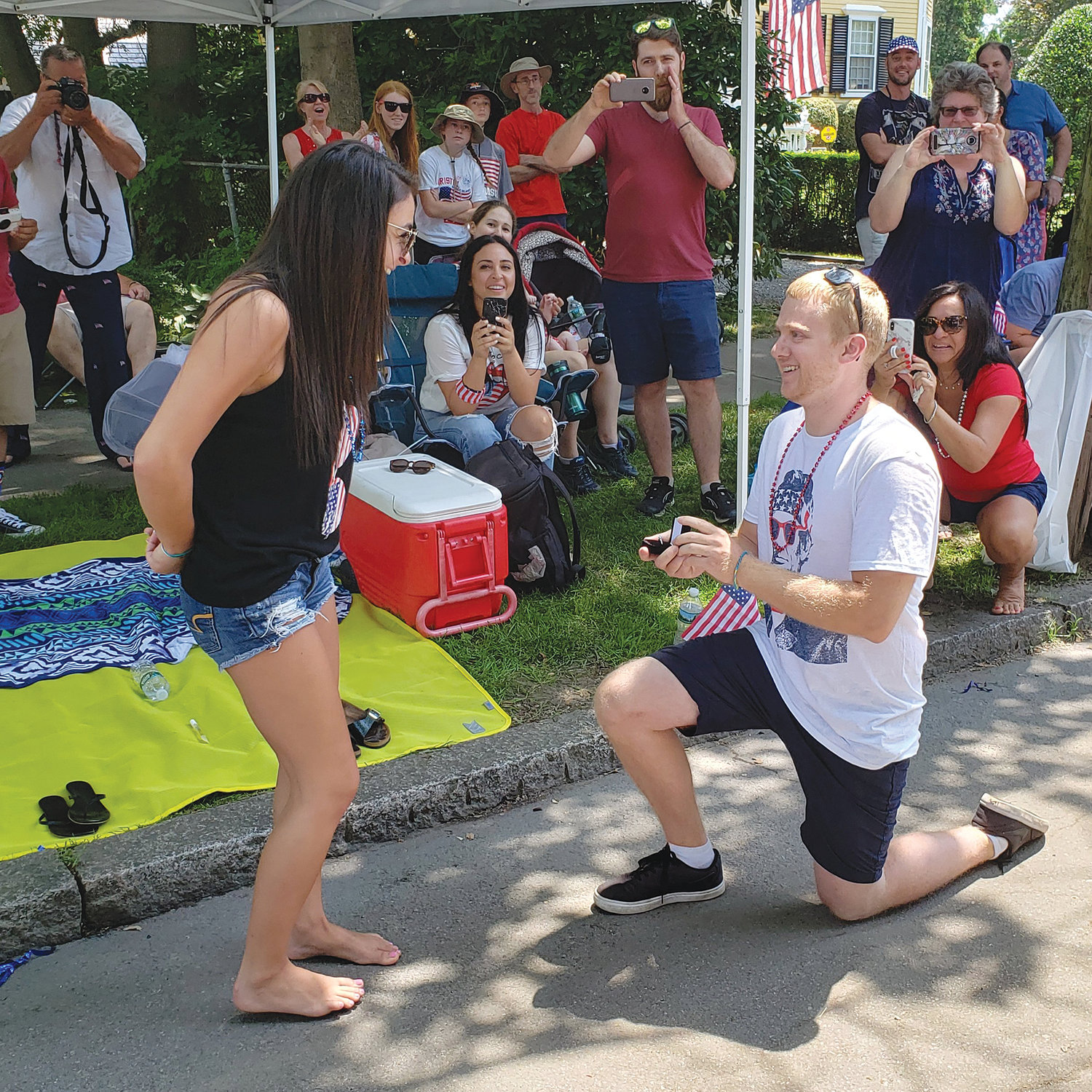 Skylar Ellison gets on bended knee and proposes to Brianna Costa  during the Bristol Fourth of July Parade last Thursday.