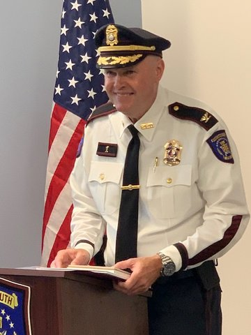 Outgoing Police Chief Thomas Lee says goodbye to the town during his retirement ceremony inside the new police station Thursday morning, July 11.