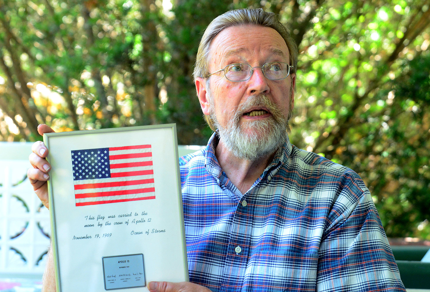 Gary Watros, holding memorabilia from one of the seminal moments in U.S. history, will be taking part in a celebration of the 50-year anniversary of the Apollo 11 landing on the Moon.