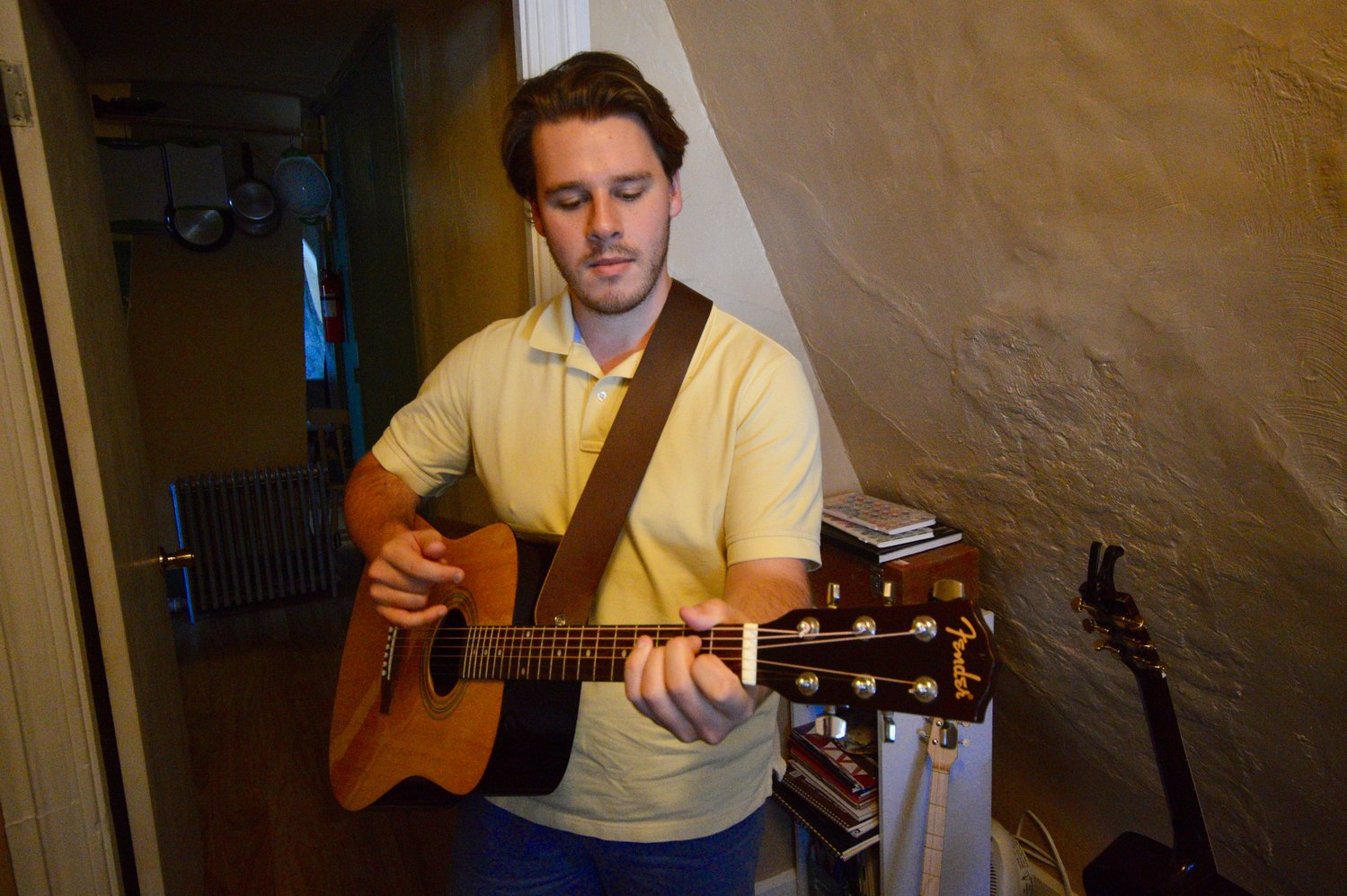 Nicholas Quigley plays acoustic guitar in his apartment's tiny music studio that's crammed with other instruments. He used guitar as a counterpoint to nature sounds he heard during a walk at Gooseberry Island in Massachusetts.