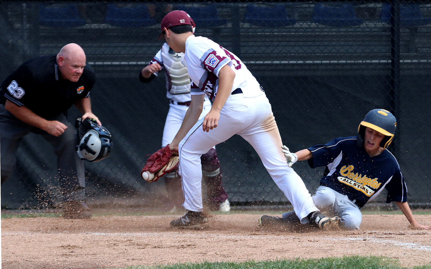 Chase Watts steals home plate after a passed ball to tie the score at 2-2 in the fourth inning.