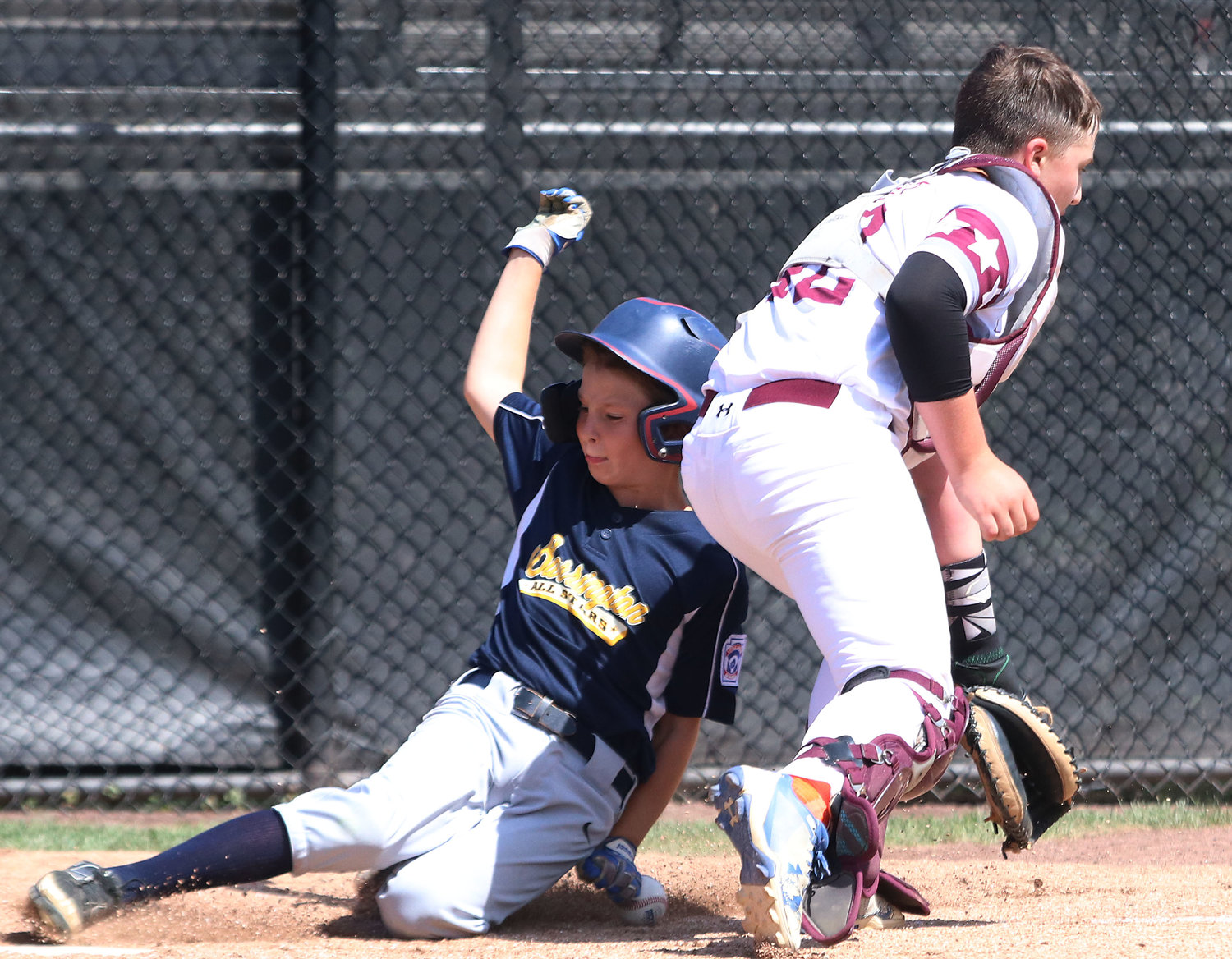 Cullen Crain slides safely in to home plate in the fourth inning.