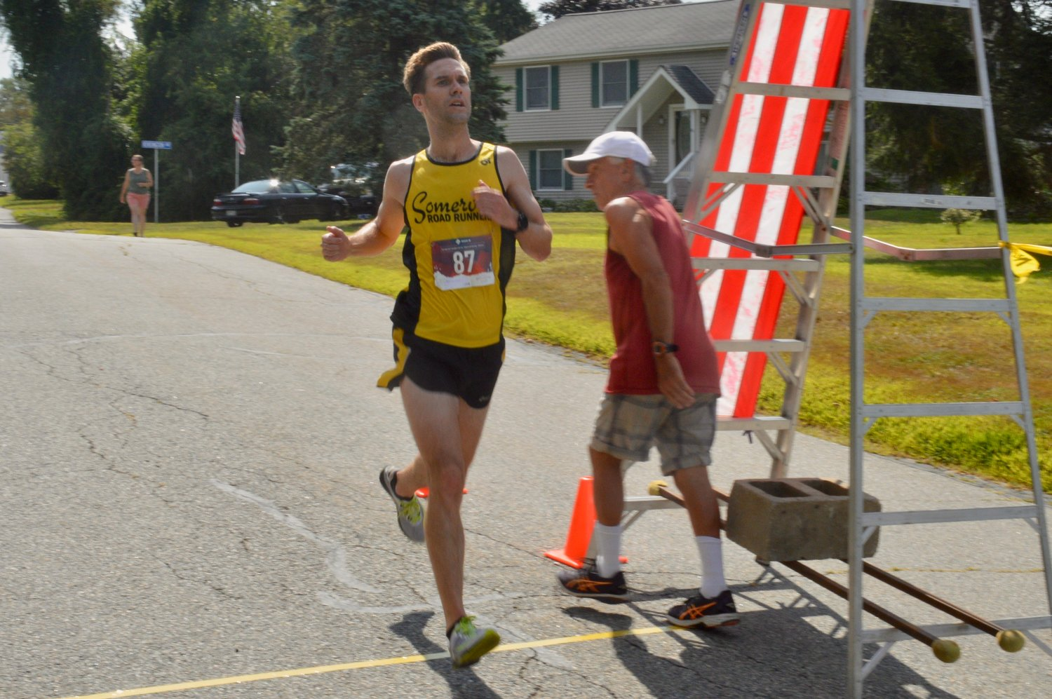 Christopher Kluczni, 37, of Needham, Mass., took second place in a time of 27:35.