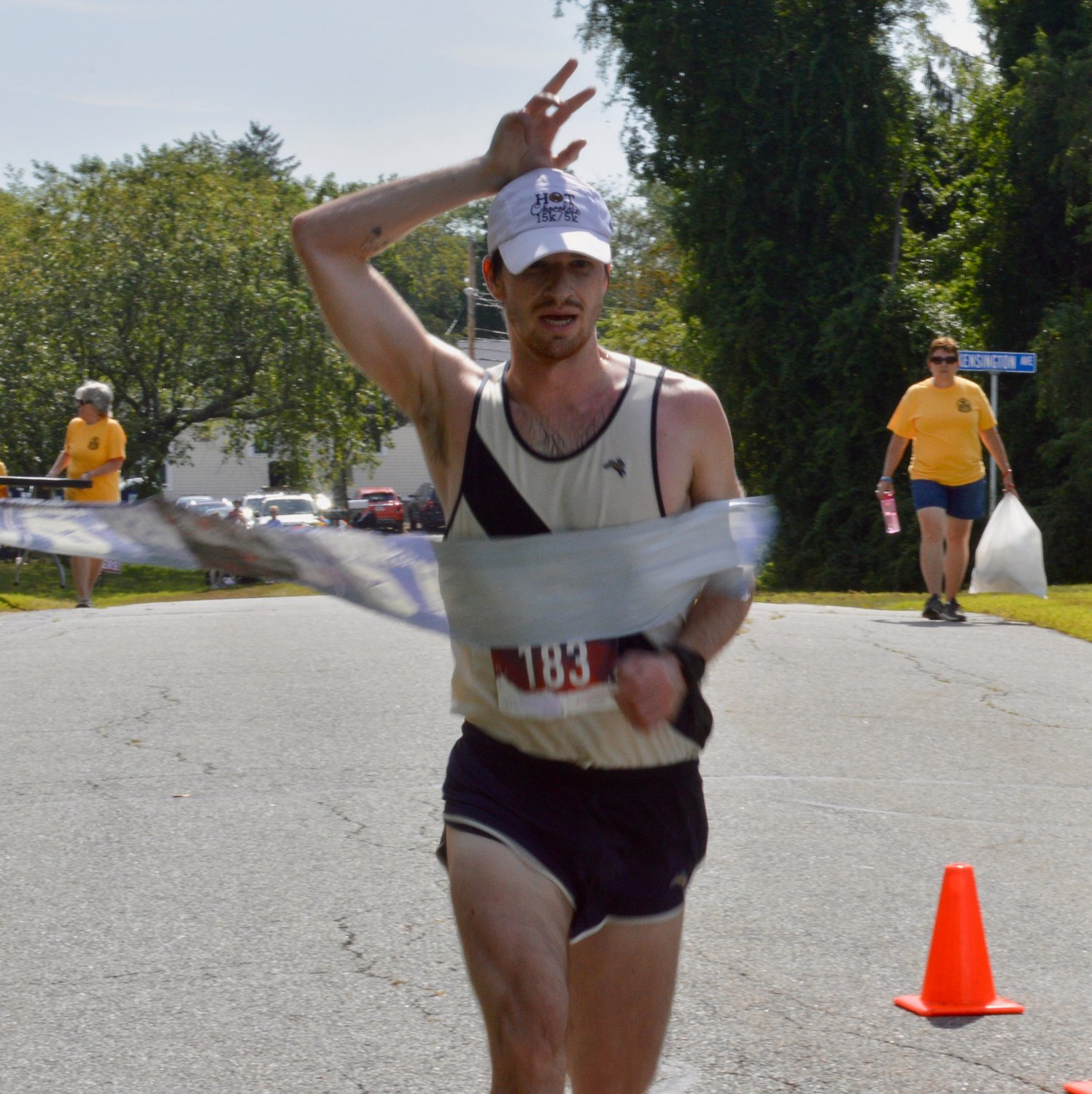 Luke O'Connor, 24, of Brookline, Mass., breaks the tape to win the Common Fence Point 5 Miler on Sunday. He finished the course in 26 minutes, 44 seconds.
