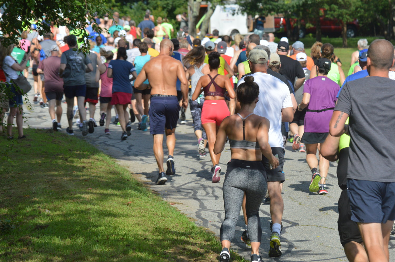 Participants in the Common Fence Point 5 Miler are off and running at the start of the race along Common Fence Point Boulevard.