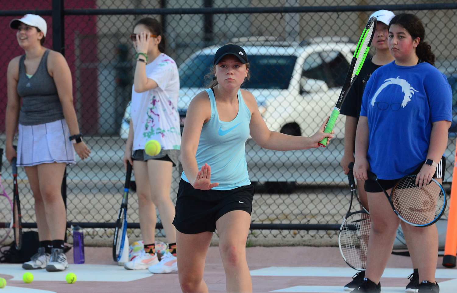Sophomore Jessica Normile runs a drill during a recent EPHS girls' tennis practice.