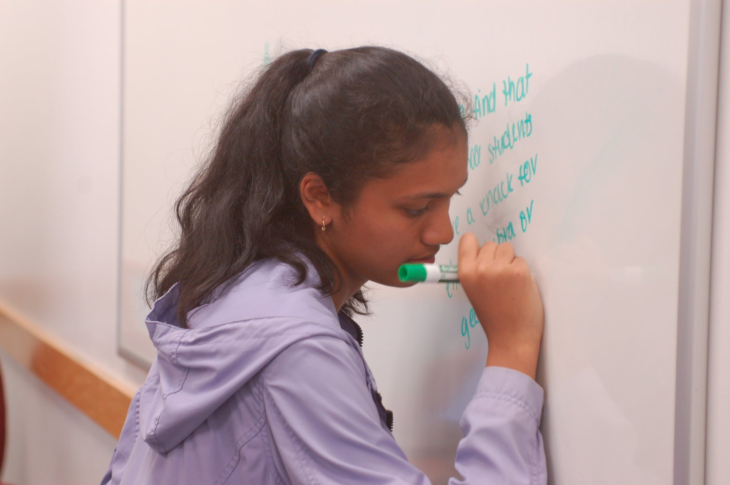 Aditi Mehta (sophomore, Bristol) serves as her team's scribe in an exercise that pitted two teams against each other in an effort to communicate information through the group.
