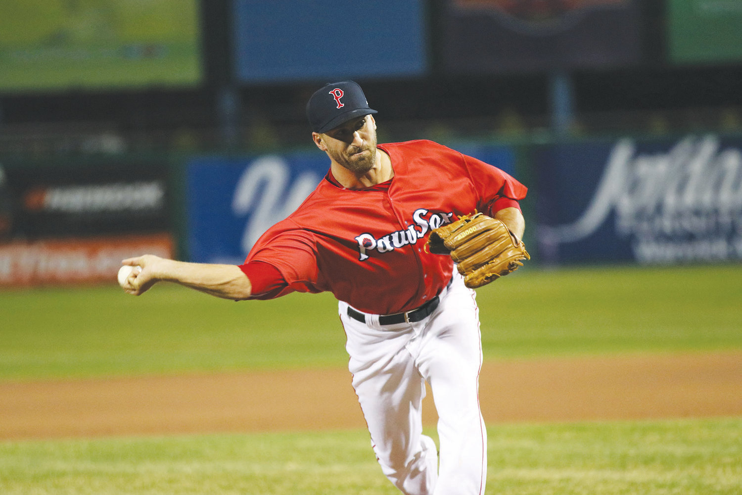 "Trevor Kelley lived in Barrington until the third grade, and returned to town recently when he was brought up to pitch for the Pawtucket Red Sox. ""I call Barrington home … I'm proud to be from Barrington and from Rhode Island, and I'll always carry that with me."""