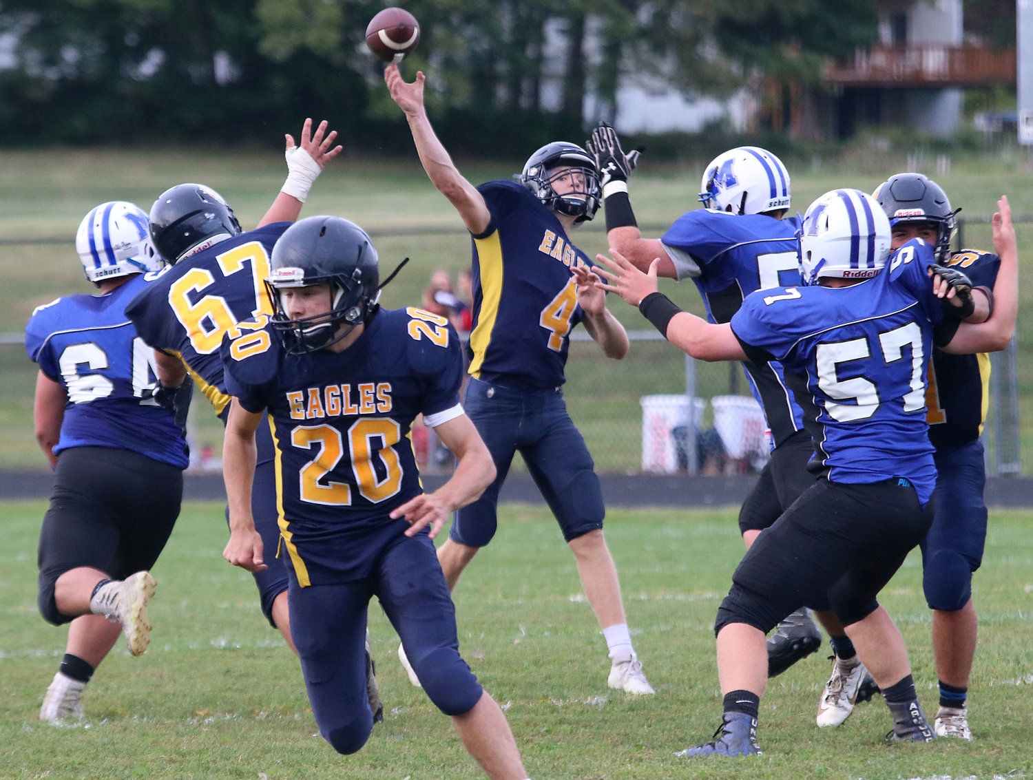 Barrington quarterback Brigham Dunphy (4) unleashes a pass during the Injury Fund game last Thursday. The Eagles' Bryan Ivatts (20) is shown running a route in the foreground.