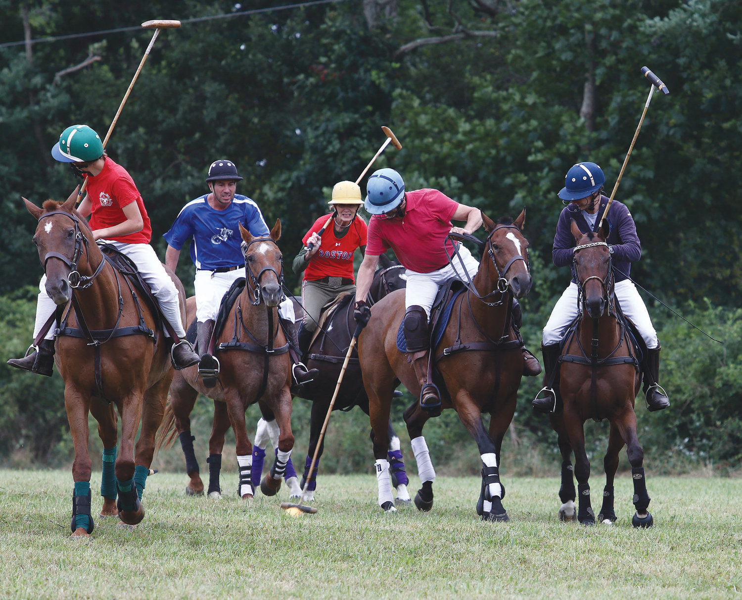 A group of players battle for control of the ball during a pickup polo match on Saturday morning at Mt. Hope Farm.
