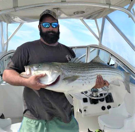 "Block Island bass: Brian Goes of Exeter with a 42"" striped bass he caught this week when fishing with eels at the southwest ledge off Block Island."