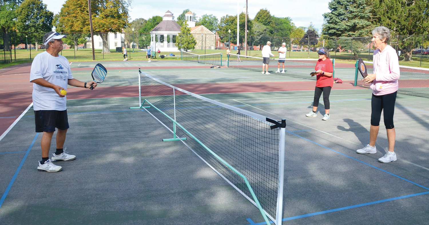 Pickleball instructor and ambassador Cliff Teixeira (left) gives Sandy Massa and Felicity Kelly valuable pointers during a recent class on the Bristol Town Common.