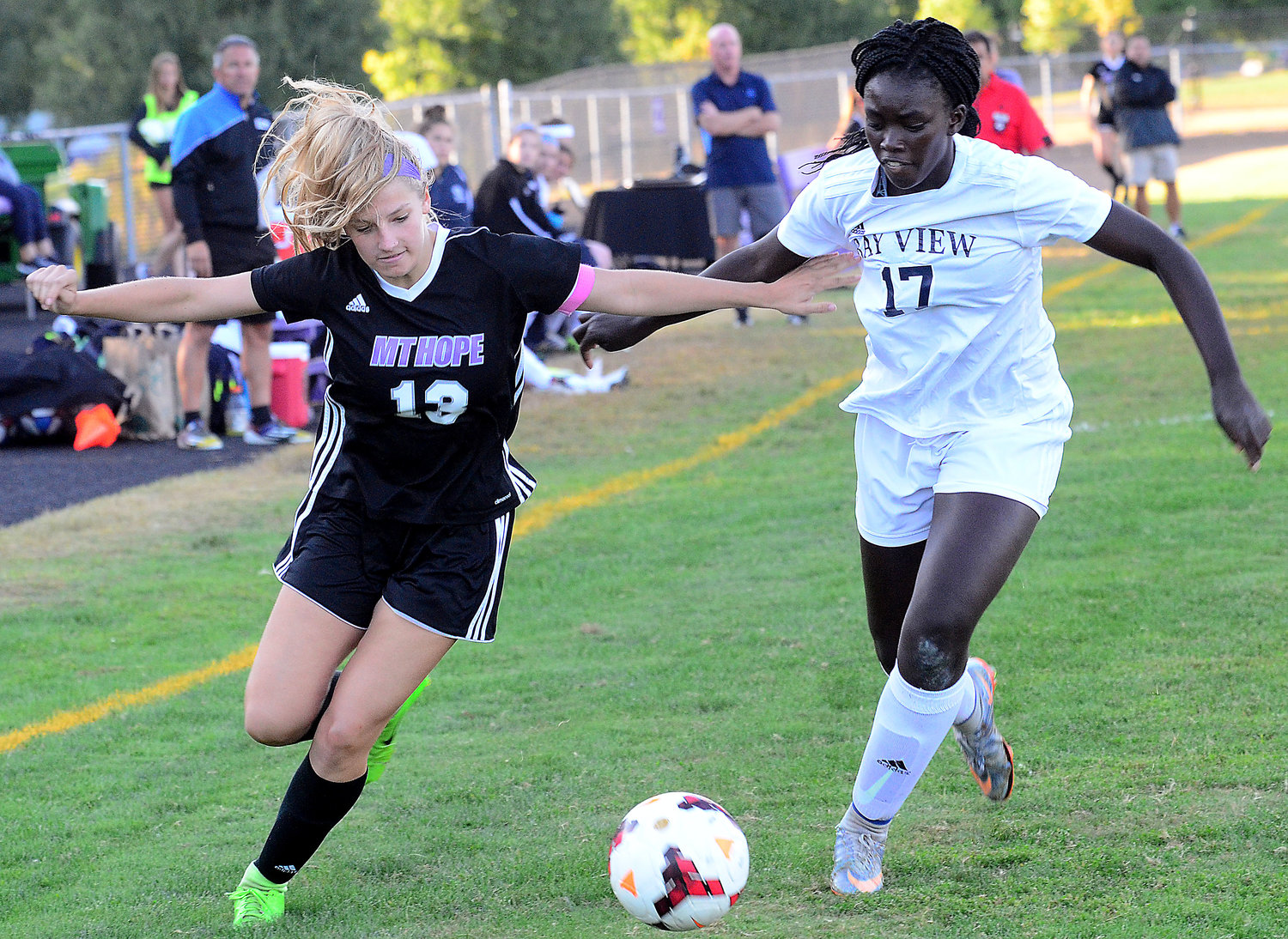 Senior forward Krista Squatrito races for the ball down the right sideline with Bay View defender Sokhna Guey in the second half.