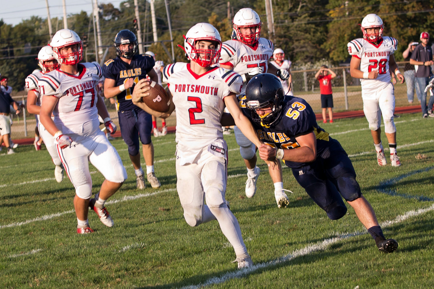 Benny Hurd stays on his feet, gaining a few more yards for the Patriots, as Barrington's Andrew Prete attempts to stop him.