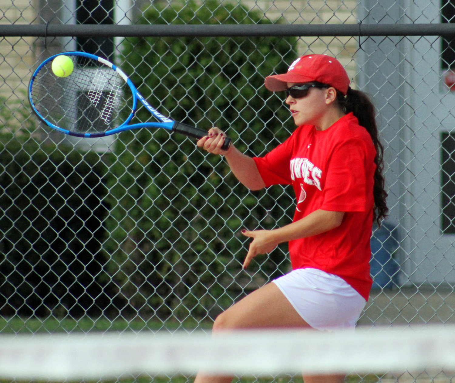 East Providence High School's Christina-Marie Capobianco hits a forehand during her singles match against Narraganset on September 26.