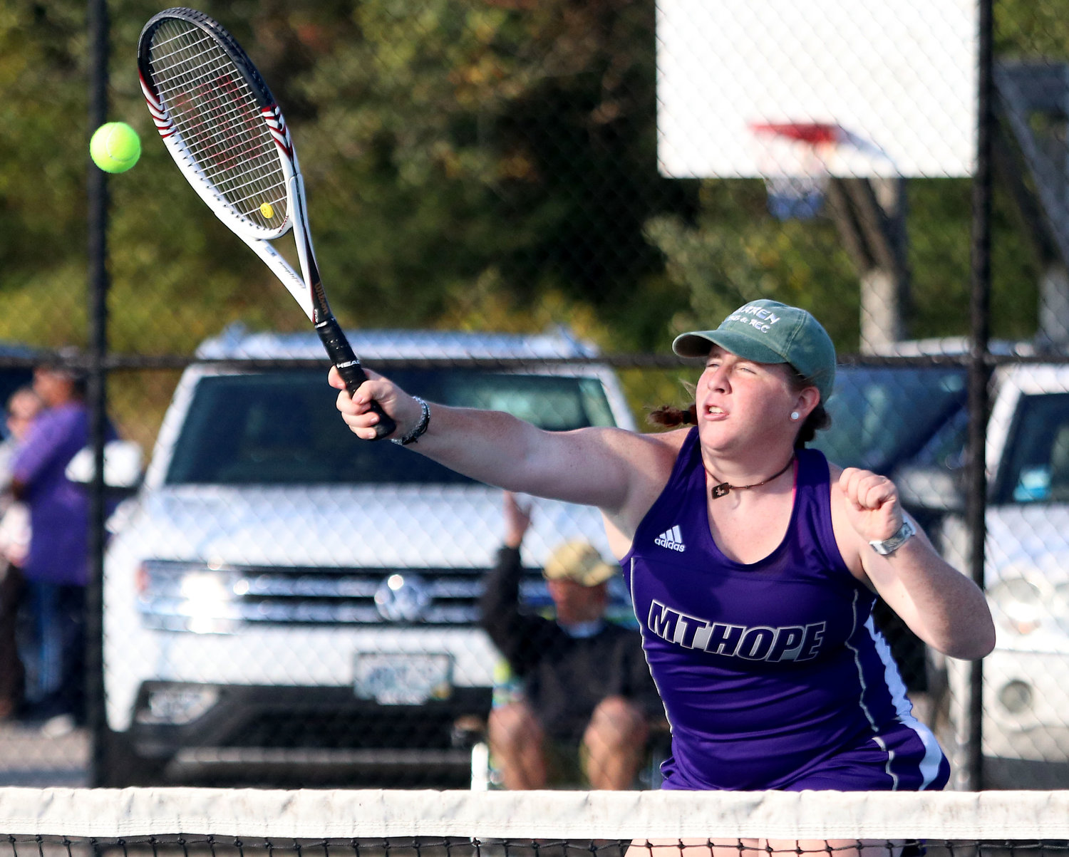 No. 1 doubles player Ellee Kopecky smashes a shot for a winner while playing at the net. She and her teammate, Annie Kryzwicki won their match in two sets.