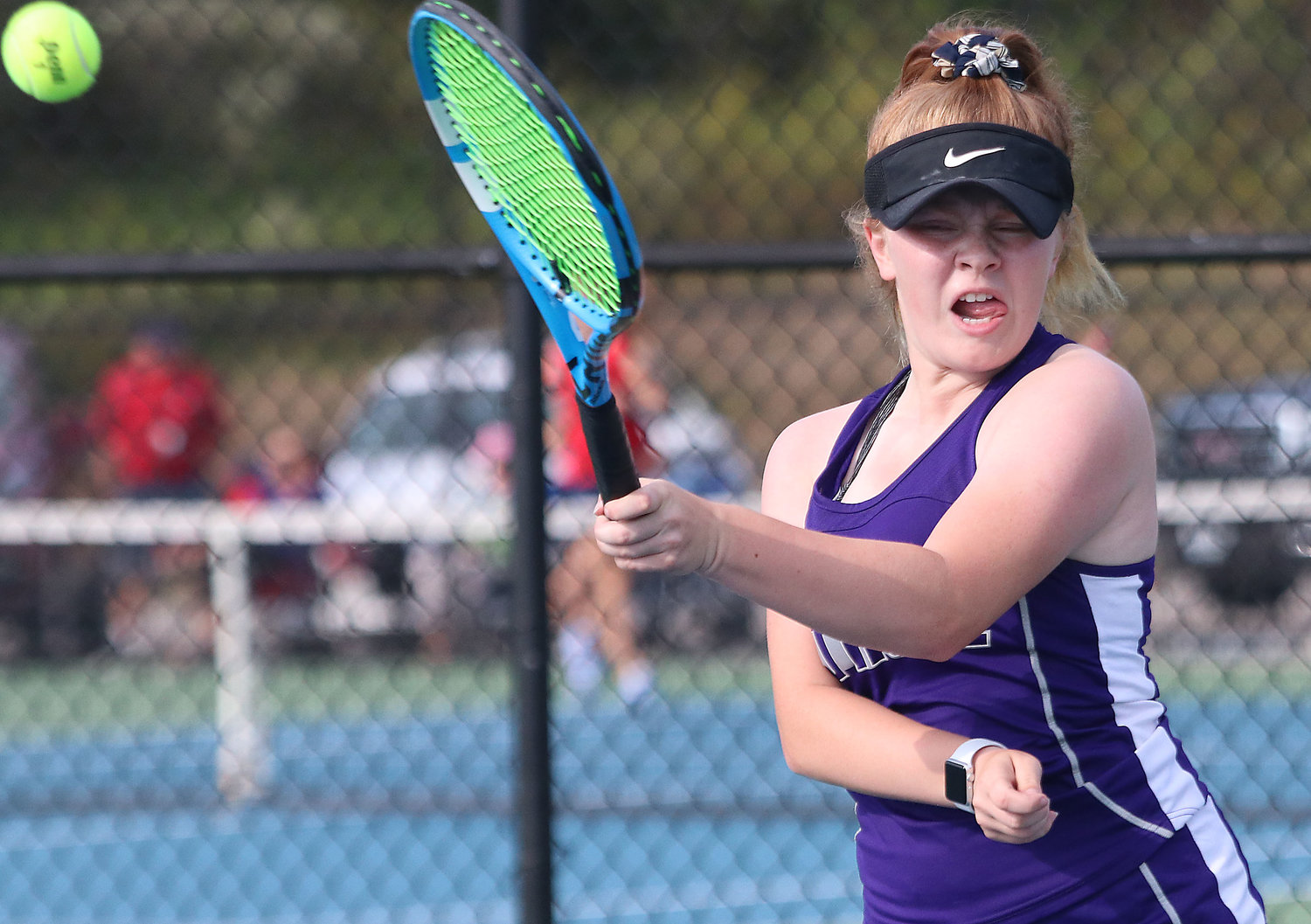 Huskies No. 1 singles player Meg Dolan hits a forehand back at Portsmouth's Delaney Lippert. She won the match in three sets.