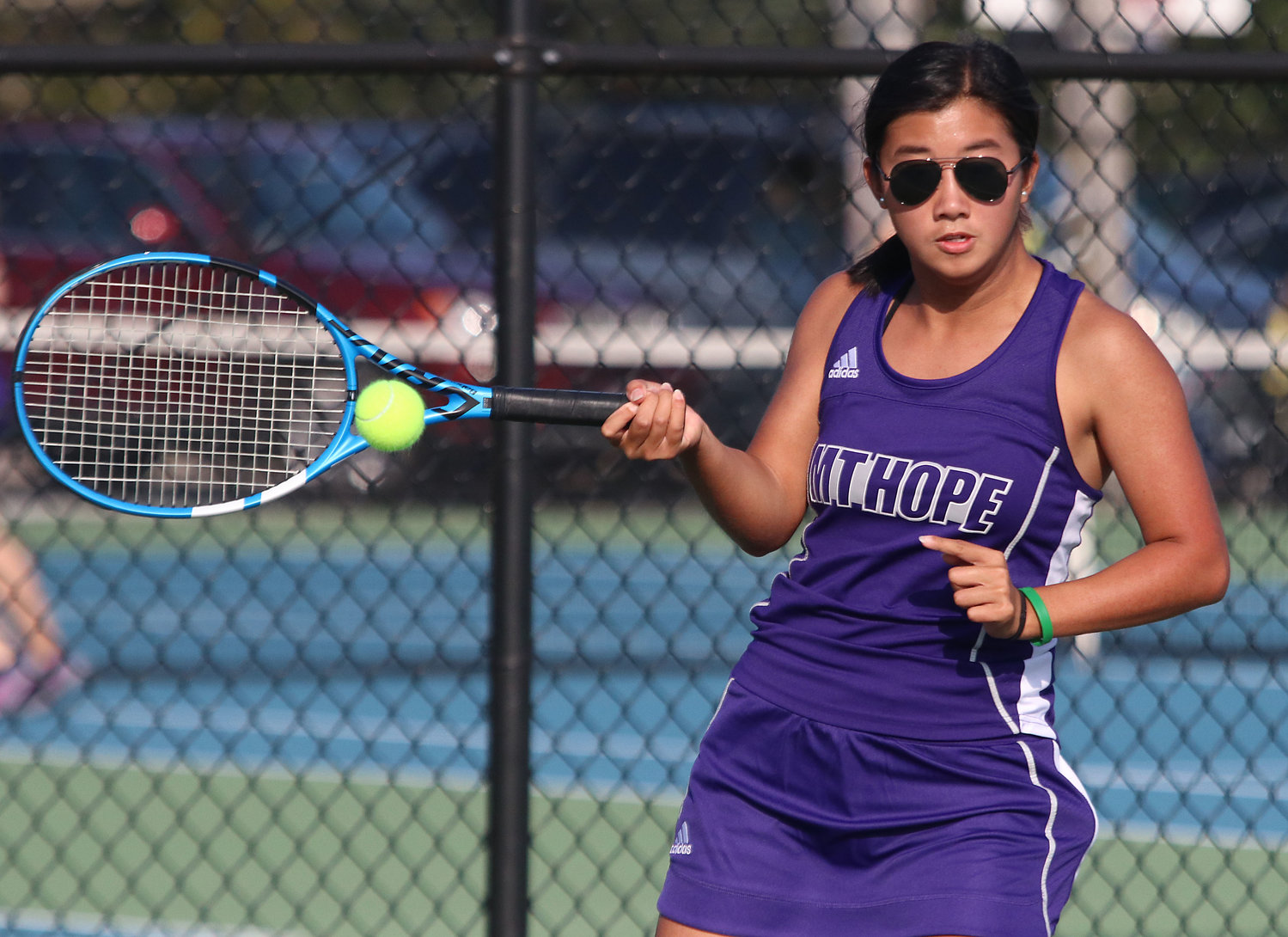 Eva White hits a forehand during her match against Jealey Barone of Portsmouth. White won 6-4, 7-5.